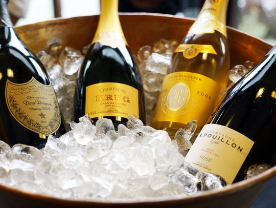 Bottles of champagne sit on ice awaiting tasters during