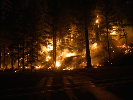 The Carr Fire burns through underbrush west of Redding, Calif., in the early hours of July 31, 2018.