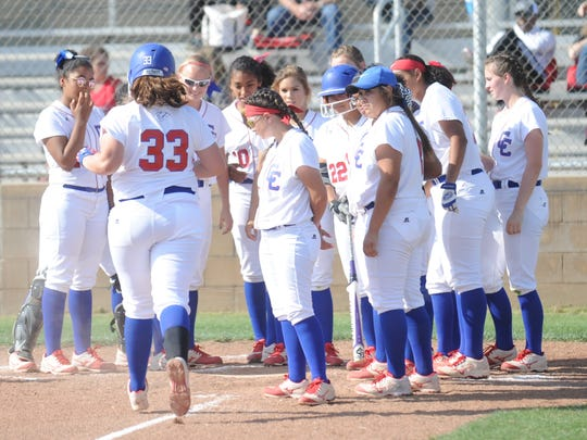 Abilene Cooper teammate wait to greet Kaitlyn Murphy after Murphy hit a solo home run in the fourth inning. It cut Lubbock Cooper's lead to 5-1. The Lady Pirates beat Abilene Cooper 9-4 in the District 4-5A game Monday, April 10, 2017 at Cougar Diamond.