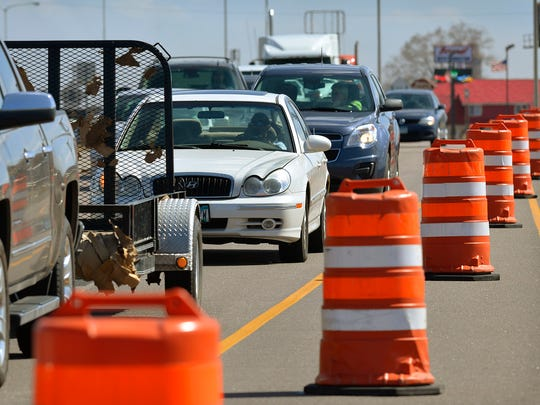 Cars slow down Thursday as they merge into one lane on U.S. Highway 10 near the Minnesota Highway 23 exit in St. Cloud.