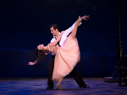 "This image released by Boneau/Bryan-Brown shows Leanne Cope and Robert Fairchild during a performance of ""An American in Paris."""