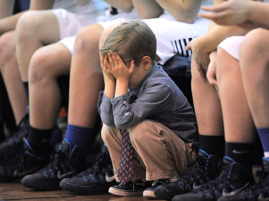 "Four-year-old Kooper Richards, son of Grosse Pointe South girls basketball head coach Kevin Richards, buries his head in his hands as the team was trailing in ""I Can't Look,"" by David Guralnick."