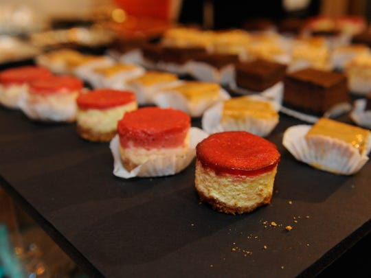 A plethora of cheecakes by Elizabeth's Moments of Joy await hungry mouths during Barrel + Board, a night filled with whiskey, beer and cheese at MonOrchid Gallery in Phoenix on Thursday, Feb. 25, 2016.
