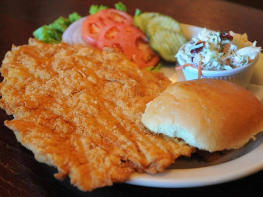 Breaded tenderloin with coleslaw at The Aristocrat, 5212 N. College Ave.