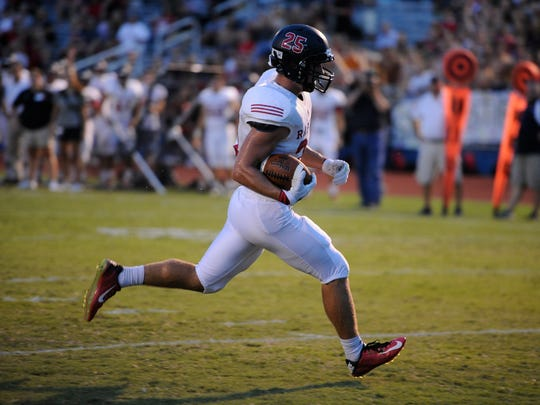 Ravenwood's Carter Nelson (25) speeds into the end zone for a touchdown against Siegel during the first quarter at Siegel High School Thursday Aug. 18, 2016, in Murfreesboro, Tenn.