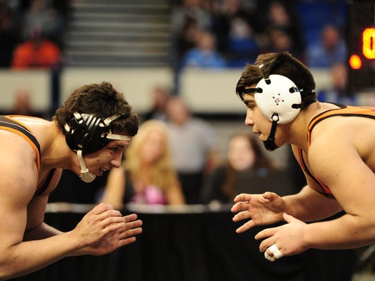 Santos Cantu of Sprague vs Cameran Campbell of Roseburg at the OSAA State Wrestling Championships at the Veterans Memorial Coliseum in Portland, Ore., on February 25, 2017. (Photo by: Alex Milan Tracy)