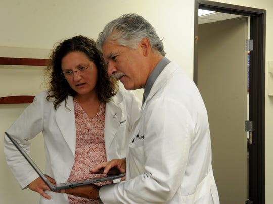 Dr. Sherilyn Wheaton with Primary Medical in Ventura confers with Joseph Diaz, a physician's assistant, outside her office. Star readers voted the family practice doctor and medical director for an urgent care the winner of this year's hardest worker contest.