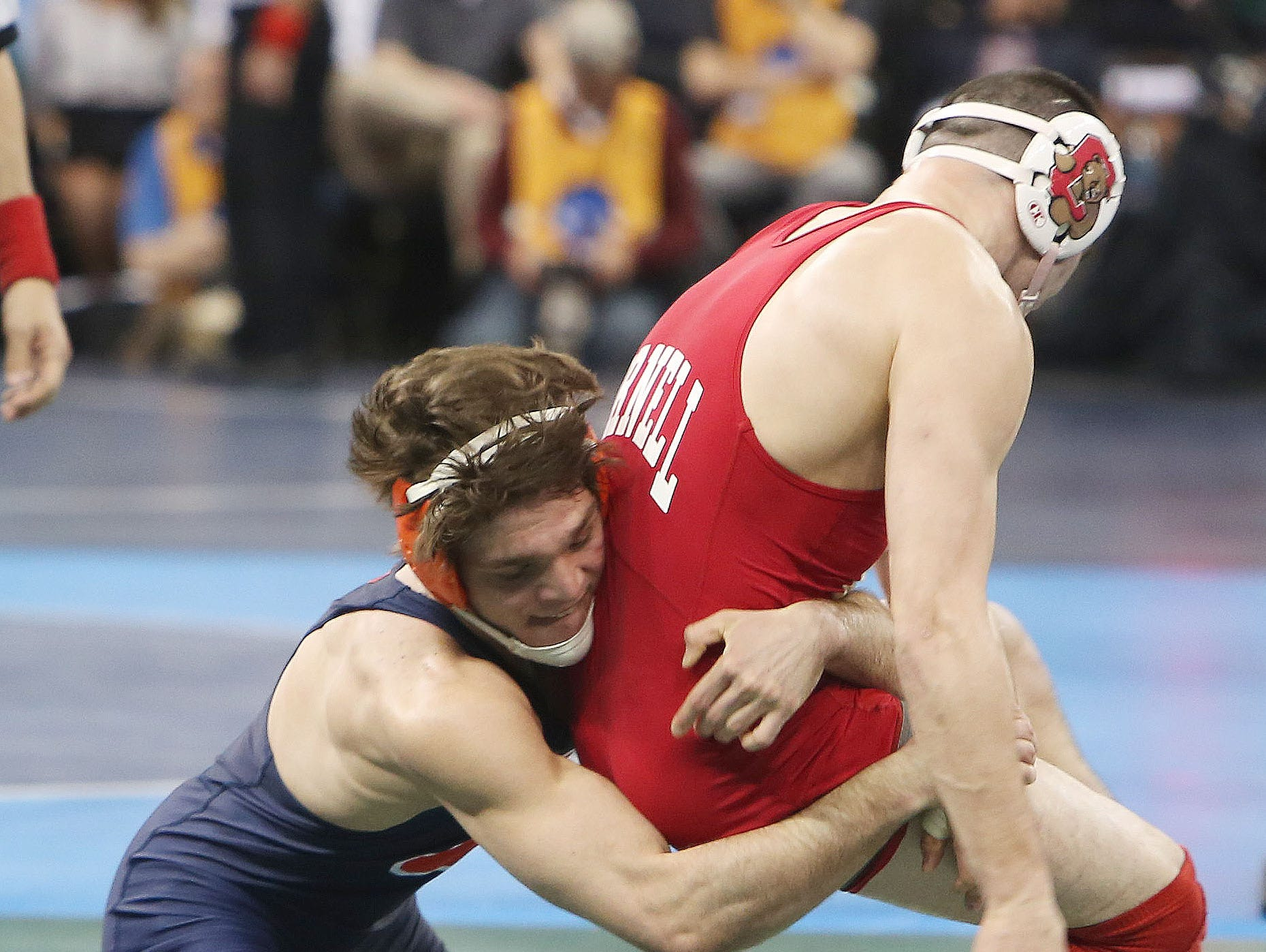 Illinois' Steven Rodrigues, left, beat Cornell's George Pickett in the quarterfinals of the 165-pound weight class during the NCAA Division I Wrestling Championships at Madison Square Garden on Thursday. Rodrigues, a Fox Lane graduate, won the match.
