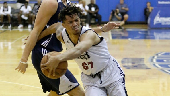Miami Heat's Damion Lee (67) draws a foul as he gets