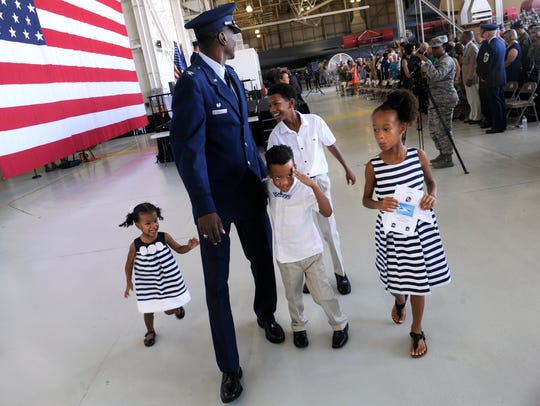 Colonel Brandon Parker walks with his children after