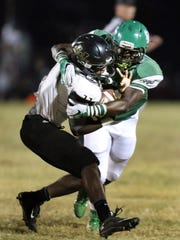 September 30, 2016 - Whitehaven senior RB Kylan Watkins (#11) is wrapped up by White Station senior DB Trevor Forbes (#4) during first half action in Region 4-6A play. The Tigers came in 6-0 and 3-0 and the Spartans of White Station entered the contest 4-2 overall and 3-0 in league. (Stan Carroll/The Commercial Appeal)