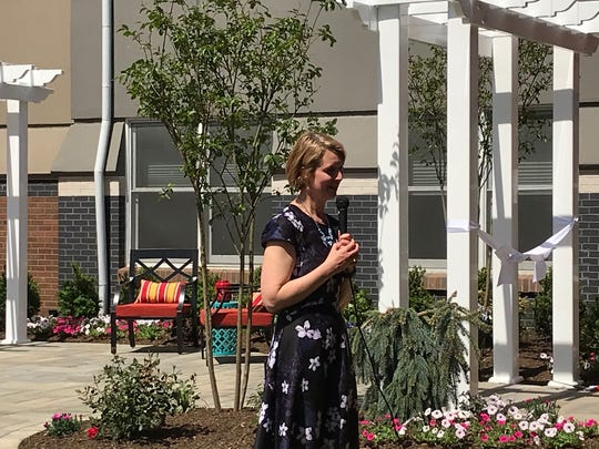 Kate Shepard, executive director/administrator at the Reformed Church Home in Old Bridge, addressed the group during the ribbon cutting ceremony for the Don Adams Tranquility Garden.