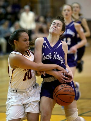 North Kitsap's Lauren Weins is stripped of the ball by Kingston's Shilene George.