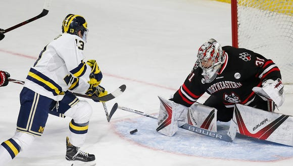 Northeastern's Cayden Primeau moves to block a shot