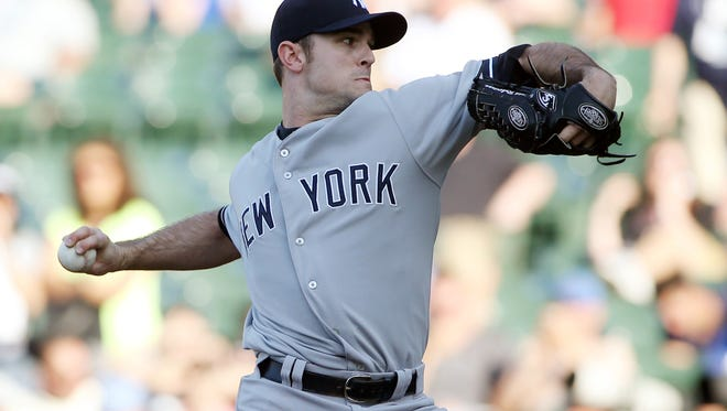 Yankees relief pitcher David Robertson throws a pitch against the Chicago Cubs during the 13th inning at Wrigley Field Wednesday.