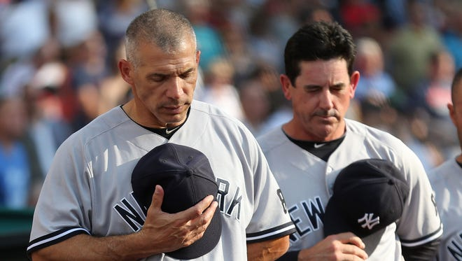 New York Yankees manager Joseph Girardi, and Rob Thomson prior to a baseball game against the Cleveland Indians Friday, July 8, 2016, in Cleveland.
