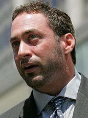 """Patrick Arnold, a chemist who helped BALCO President Victor Conte develop the steroid known as """"the clear,"""" speaks to reporters after a sentencing hearing in August 2006 in San Francisco."""