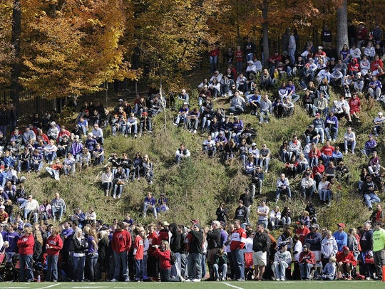 Fans line the hillside in the second quarter at Clemens