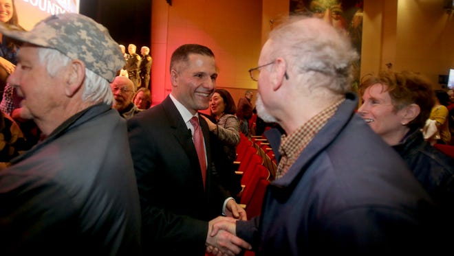 Dutchess County Executive Marc Molinaro greets supporters after he delivered his State of the County Address at the Culinary Institute of America in Hyde Park Feb. 28, 2018.