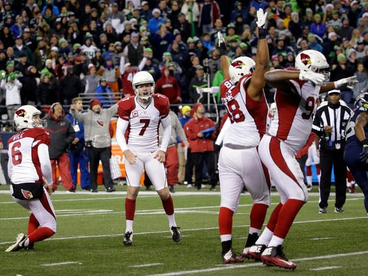 Arizona Cardinals kicker Chandler Catanzaro (7) reacts as teammates cheer after he kicked a winning field goal on the final play against the Seattle Seahawks in an NFL football game, Saturday, Dec. 24, 2016, in Seattle. (AP Photo/Ted S. Warren)