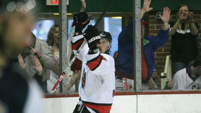 Jeff Zehr puts his arms in the air after scoring against Flint during the 2008 International Hockey League Playoffs at McMorran Arena. Zehr was recently named head coach of the London Lakers in the GMHL.