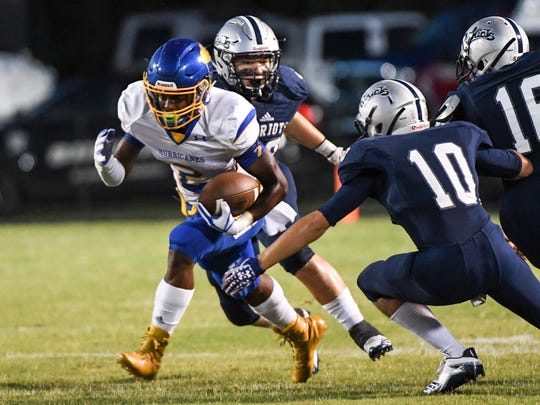 Wren senior Trey Gray (2) runs near Powdersville senior Gavin Agin (10) during the first quarter at Powdersville High School on Friday.