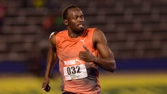 Usain Bolt, winner in 10.04 seconds, competes in the