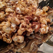 Caramel, chocolate and cheese turn popcorn into a decadent homemade snack