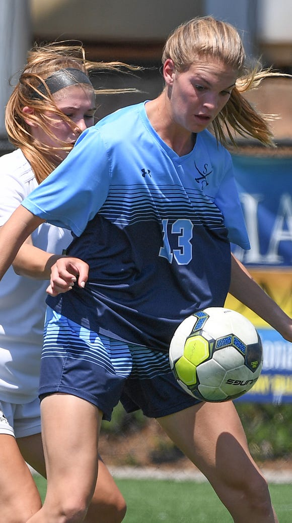 Southside Christian's Mary Kate Wyer (13) keeps the