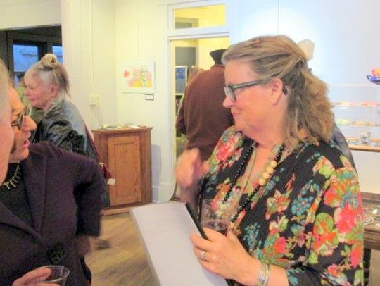 Joan Malkerson greeted visitors to the opening night