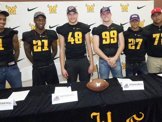 Six Parkalnd High School seniors held a joint signing