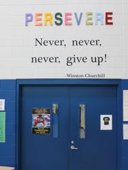 Words of encouragement, including 'Persevere' in the gymnasium, are at Townville Elementary School.