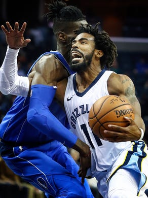 Memphis Grizzlies guard Mike Conley (right) drives