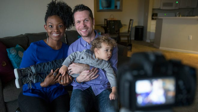 """Gabrielle Flowers Rader, with husband Chad Rader Sr., and Chad Rader Jr., 22 months, who produce the """"GabeBabeTV"""" YouTube show, at their apartment in Fishers, Thursday, Nov. 6, 2014."""