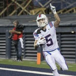 Louisiana Tech Bulldogs wide receiver Trent Taylor (5) celebrates after scoring a touchdown against Rice.