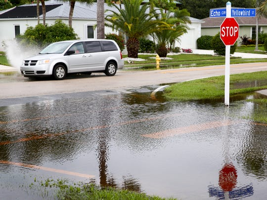 Heavy rains over the last few days have left standing water on several roads and driveways Wednesday, June 7, 2017 in Marco Island, Fla.