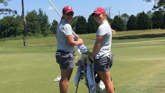 FSU head coach Amy Bond and freshman Kathleen Sumner on the course for Monday's first round of the Tallahassee Regional.
