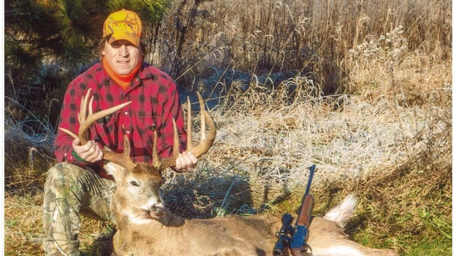 Max Muzynoski poses with the 14-point buck he shot on the final Friday of the gun hunting season last November.