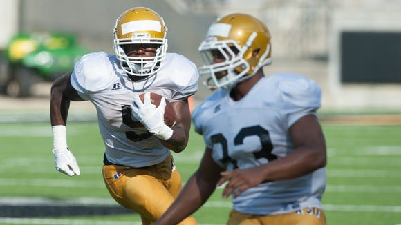 Alabama State University running back Alex Anderson carries the ball during the scrimmage held at Hornet Stadium on the ASU campus in Montgomery, Ala., on Saturday August 22, 2015