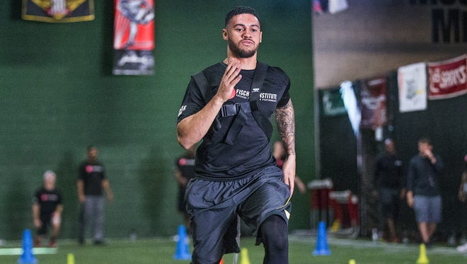 Former Arizona State player D.J. Foster works out at The Fischer Institute during the NFL Combine Prep, Tuesday, February 16, 2016.  A couple dozen former collegiate football players are preparing for the NFL combines and a shot at the big time.