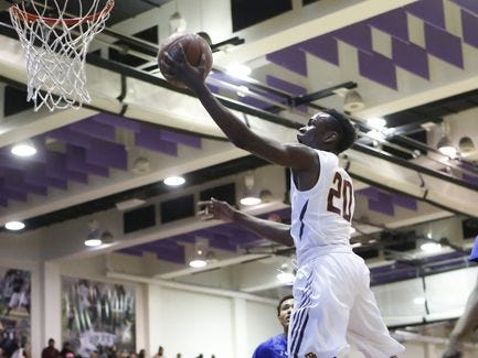 Mount Vernon's Marco Morency (20) puts up a shot against Cardozo High School in the SNY Invitational NYC High School Basketball Showdown at the City College of New York on Friday, Jan. 29, 2016.