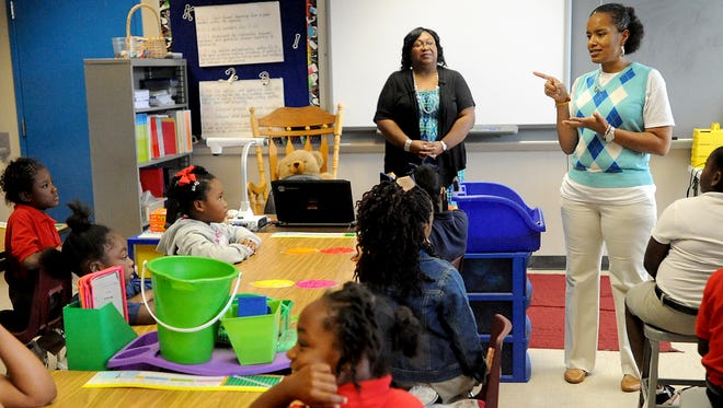 April King, the director of the Girls of Essence program at Caddo Heights Elementary in Shreveport, talks to her group during a meeting and the school.