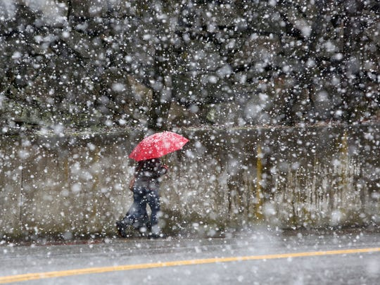 12:57 p.m. A pedestrian makes her through heavy snow flurries in Tarrytown, New York during a winter storm March 7, 2018.