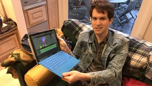 Sam Graham displays his new Microsoft Surface Pro--he