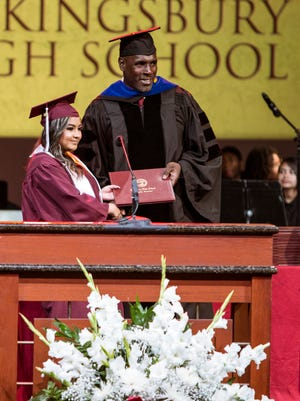 Principal Dr. Terry Ross shakes hands with 2018 graduates during the 2018 Kingsbury High School graduation ceremony.