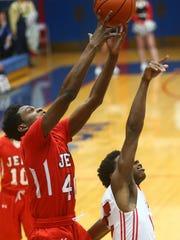 Lafayette Jeff's James Burns grabs a rebound against