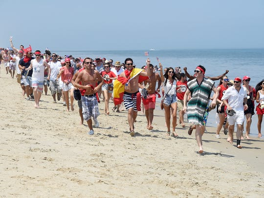 """The 18th Annual Running of the Bull was held Saturday July 12th in Dewey Beach at the Starboard with a record crowd on hand to have the """"Bull"""" chase partier's  down the beach and celebrate at the Restaurant and Bar with entertainment by Laura Lea & Tripp Fabulous."""