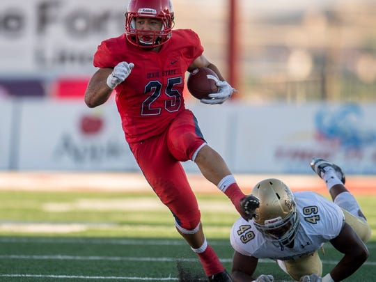 Dixie State University running back Sei-J Lauago (25) avoids a tackle on a carry against South Dakota Mines at Sark Arslanian Field Saturday, September 22, 2018.