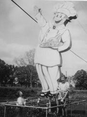 This waving chef sign is pictured in 1953 outside of Poor Boy's Riverside Inn.