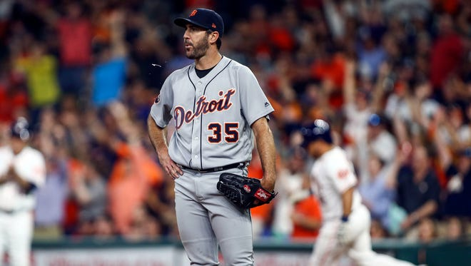 Tigers pitcher Justin Verlander (35) reacts and Astros catcher Juan Centeno (30) rounds the bases after hitting a home run during the fourth inning of the Tigers' 7-6 loss Thursday in Houston.
